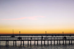 A bridge spans the Bay of La Paz and is silhouetted in a sunset. Royalty Free Stock Photo