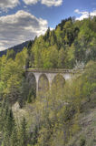 Bridge in spring. Bridge over a valley in the mountains Stock Photography