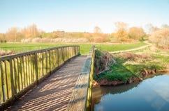 Bridge into the spring light Stock Image