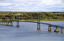 Bridge on St. Lawrence River. The bridge connectint the mainland and the Isle d'Orleans on the St. Lawrence River royalty free stock photos