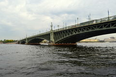 Bridge in St. Petersburg. Old bridge over the river Neva stock photos