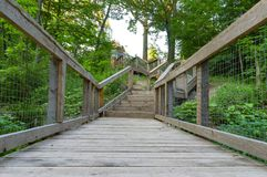 Bridge and stairs leading out of a nature walk royalty free stock photos