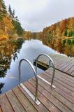 Bridge stairs to autumn lake Stock Image