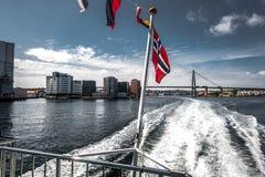 Bridge in Stavanger & norwegian flag. Bridge in Stavanger through the fjord, and the norwegian flag royalty free stock photos