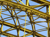 Bridge steel construction. Yellow bridge steel construction on blue sky Stock Images