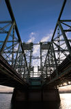 Bridge with steel trusses and lifting towers on a wide concrete Royalty Free Stock Image