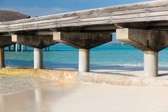 Bridge on stilts at exotic resort beach Stock Photo