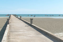 Bridge stone on the beach and sea with blue sky. Bridge stone beach sea blue sky Stock Photography