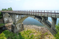 The bridge from a stone on the railroad Royalty Free Stock Images