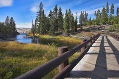 Bridge through a stream Royalty Free Stock Image