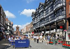 Bridge street shops and cafes, Chester. Royalty Free Stock Images