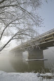 Bridge stretching into the frosty fog. Caucasus, Russia Stock Image