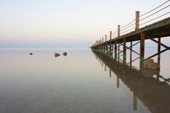 Bridge stretching out into vast ocean Royalty Free Stock Photos