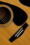 Bridge and strings. An acustic guitars bridge and strings Royalty Free Stock Photo