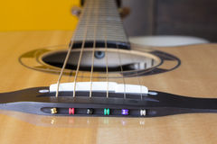 Bridge and strings installation of acoustic guitar Stock Photography