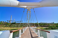 Bridge of Strings and Power Plant Station in Israel. The Bridge of Strings in Hadera Stream Water Park with the Orot Rabin (formerly Maor David) power plant in stock photography