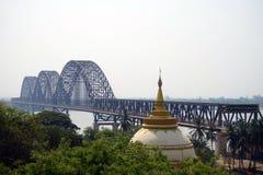 Bridge and stupas. MANDALAY, MYANMAR - CIRCA APRIL 2017  Bridge and stupas on the Sagaing hill Stock Images