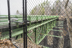 Bridge with suicide prevention barrier and security camera Stock Images