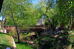 Bridge and Summertime Foliage. A bridge over the river with trees and summer foliage all about Stock Photography