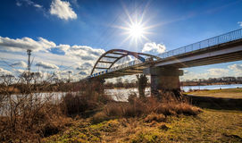 Bridge and sun. Rays. Day at the beginning of spring Royalty Free Stock Photos