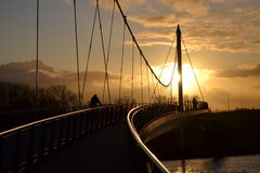 A bridge with the sun going under Royalty Free Stock Photo