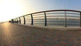 Bridge on sunrise seaside Royalty Free Stock Image