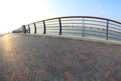Bridge on sunrise seaside Royalty Free Stock Photos