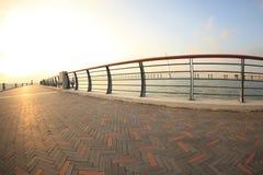 Bridge on sunrise seaside Stock Image