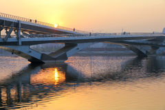 Bridge in sunset. The sunset scenery with bridge and river Stock Photo