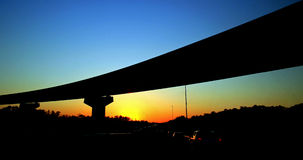 Bridge Sunset. Silhouette of a bridge from a road at sunset Stock Photo