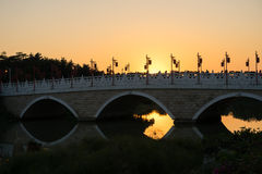 Bridge sunset. Sunset moment bridge in the park Royalty Free Stock Images