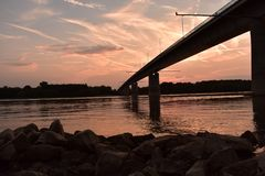 Sunset over the river Danube. Bridge in the Sunset over the river Danube, Hungary stock photo