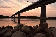 Sunset over the river Danube. Bridge in the Sunset over the river Danube, Hungary stock image