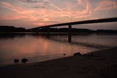 Sunset over the river Danube. Bridge in the Sunset over the river Danube, Hungary royalty free stock photos