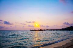 Bridge among the sunset sea stock photography
