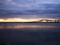 Bridge at sunset on the waterfront or newer bay. Royalty Free Stock Image