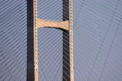 Bridge Superstructure. Detail of suspension bridge superstructure, illustrating latticework pattern of cables, photographed in evening sunlight Stock Images