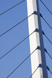 Bridge support against a blue sky. Bridge support with cables against a blue sky stock photos
