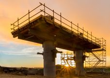 Supports Construction. Bridge support under construction at sunset Stock Images
