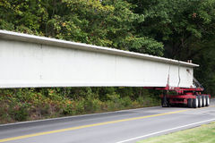 Bridge supports being transported to the construction site. Stock Image