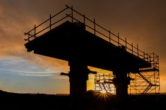 Bridge Supports Construction. Bridge support under construction at sunset Royalty Free Stock Photos