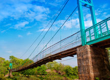 Bridge. Suspension bridge spanning the waterfall Stock Photography