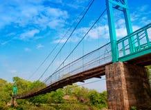 Bridge. Suspension bridge spanning the waterfall Stock Photography