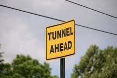 Underground Tunnel Underpass. A bridge system on an interstate or freeway system that has an underground, underwater tunnel that travelers pass through and under royalty free stock image