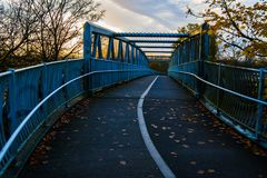 Bridge taking on a blue hue in the dawn light Royalty Free Stock Photography
