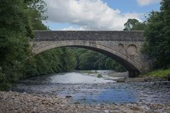 Bridge in Teesdale. Brick bridge in Teesdale, going over River Tees Stock Image