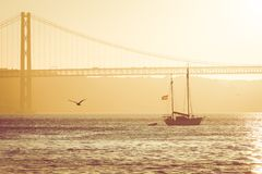 Bridge 25th of April in Lisbon, Portugal at sunset.  Royalty Free Stock Photography