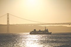 Bridge 25th of April in Lisbon, Portugal at sunset.  Royalty Free Stock Photos