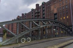 On the bridge there are bicycles and a view of brick houses stock photography