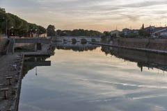 Bridge of Tiberius at sunset in Rimini, Italy. Stock Image